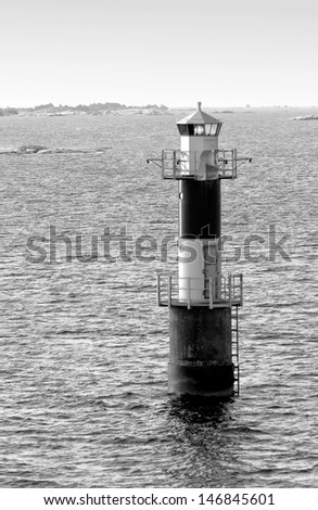 Automatic lighthouse in the archipelago of the Aland Islands, Finland (black and white) - stock photo