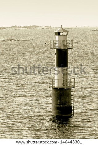 Automatic lighthouse in the archipelago of the Aland Islands, Finland (stylised retro) - stock photo