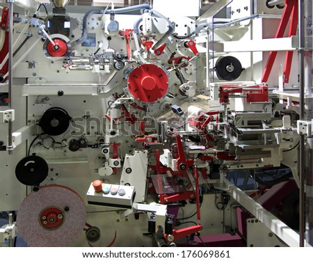 Automatic machine for packing tea in bags and boxes - stock photo