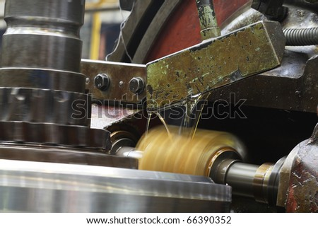 automatic milling cutter in move in heavy industry machinery - stock photo