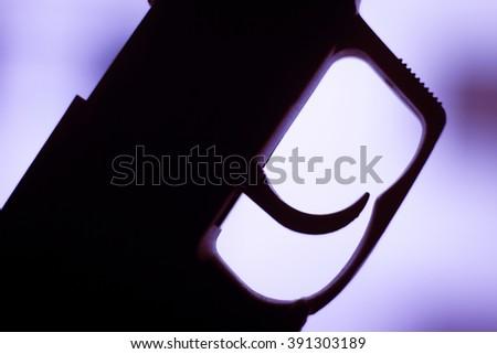 Automatic 9mm pistol handgun weapon in blue photo. - stock photo