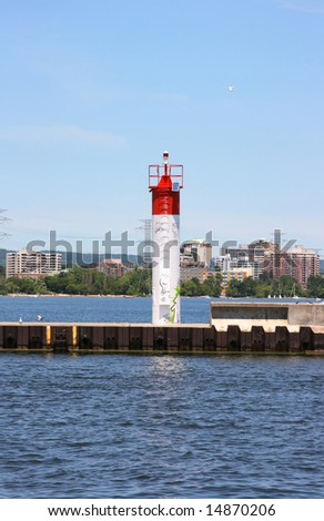 Automatic navigatiuon light on exit of the canal to the lake. - stock photo