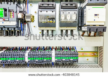 Automatic programming relay has control over electrical panel, power lines located inside of the switch box. - stock photo