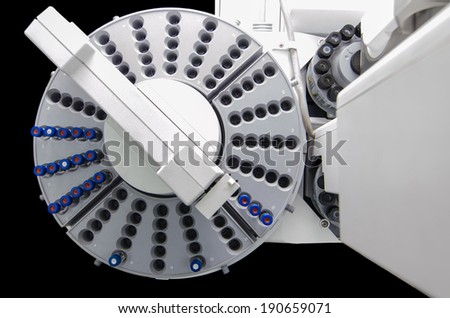 Automatic sample handling of analytical instrument isolates on black in bird's eye view - stock photo