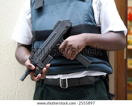 Automatic uzi machine gun, hand hald, close up - stock photo