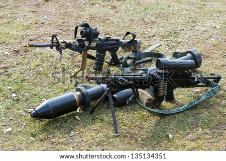Automatic weapons and a bazooka standing on the ground during a briefing of special forces - stock photo