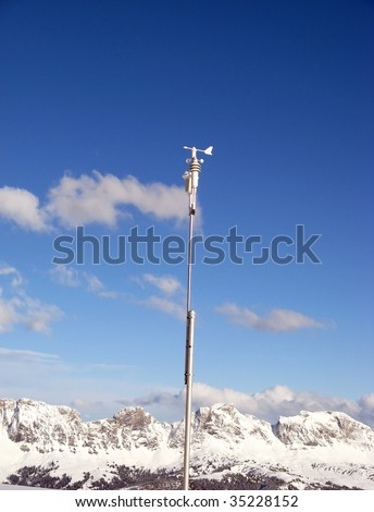 Automatic weather station against blue sky - stock photo