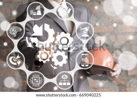 Automation Integration Industry 4.0. Smart Industrial Information Technology Concept. Man with safety helmet offers gears arrows mechanism icon on virtual screen.