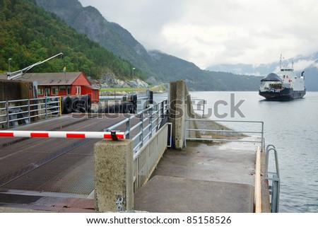 Automobile apron and ferry in Norwegian Fjord - stock photo