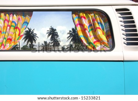 Automobile bus with a view on palms