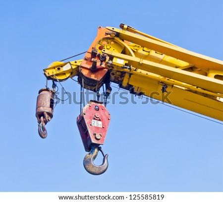automobile crane with blue sky - stock photo
