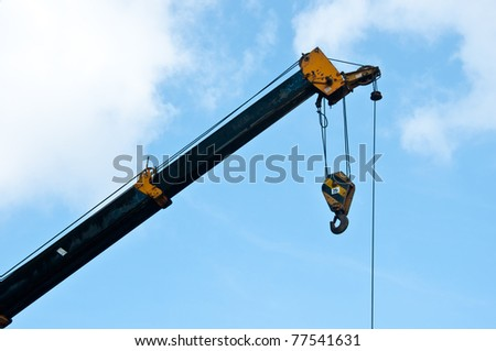automobile crane with blue sky - stock photo