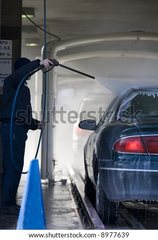 Automobile going through the car wash - stock photo