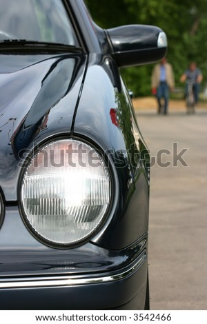 Automobile headlight and people on a background - stock photo