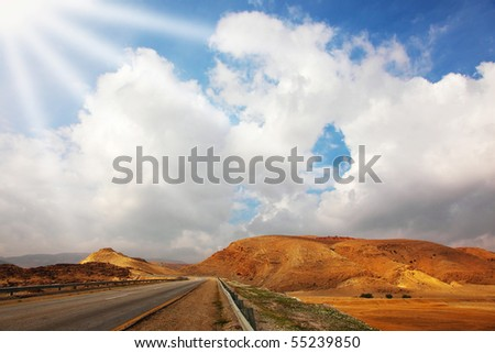 Automobile highway in desert Sinai in solar December day - stock photo