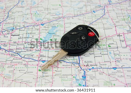 Automobile key against Road Map background - stock photo