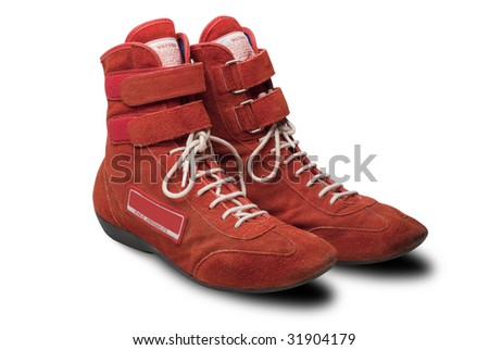 Automobile racing shoes in red swede with shadow and clipping path - stock photo