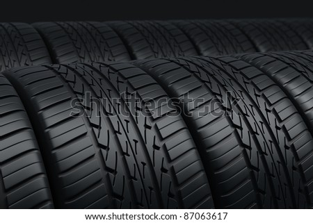 Automobile tires perspective view (depth of field and close-up) - stock photo