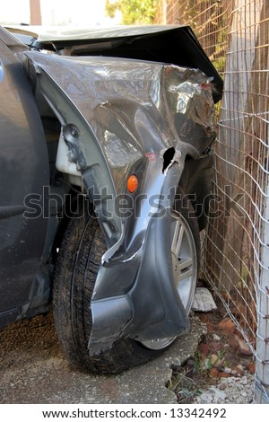 Automobile with front end badly damaged after a collision with another car - stock photo