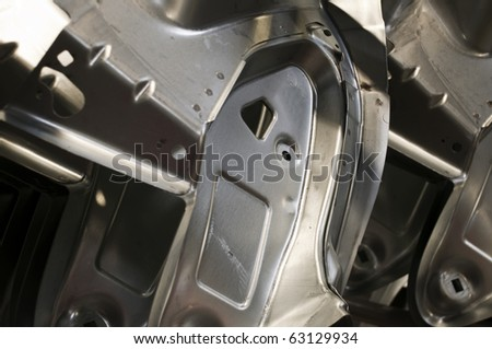 Automotive industry - spare  metal parts of car skeleton - stock photo