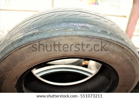 Automotive tires damage, burst, leakage. Changing tires in the garage.