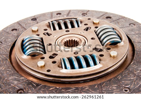 Automotive used friction disc clutch component isolated on white - stock photo