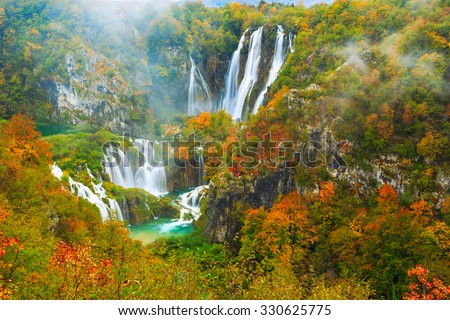 Autum colors and waterfalls of Plitvice National Park in Croatia - stock photo