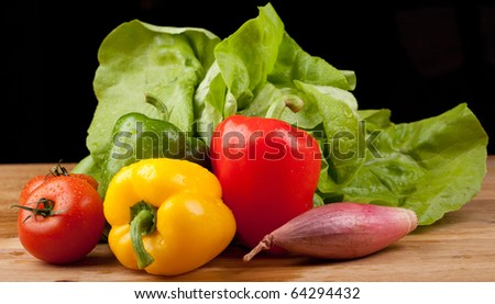 autum vegetables,on a wooden board,black background - stock photo