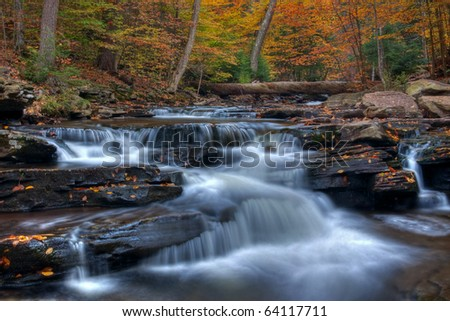 Autumn arrives at Kitchen Creek, Ricketts Glen State Park Pennsylania. - stock photo