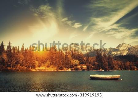Autumn at alpine mountain lake - stock photo