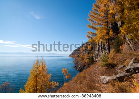 Autumn at Lake Baikal - oldest, deepest and most voluminous freshwater lake in the world, Irkutsk region, Siberia, Russia - stock photo