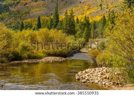 Autumn at Mountain Creek - Autumn view of Glacier Creek, near Bear Lake, in Rocky Mountain National Park, Estes Park, Colorado, USA. - stock photo