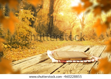 autumn background of leaves and table