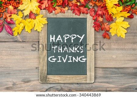 Autumn Background with colorful leaves and blackboard. Sample text Happy Thanksgiving - stock photo