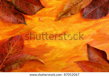 Autumn background with colorful leaves over acrylic painted paper, with copy space - stock photo