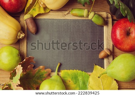 Autumn background with fruits and leaves - stock photo