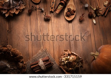 autumn background with fruits and spices with dried flowers place for inscription - stock photo