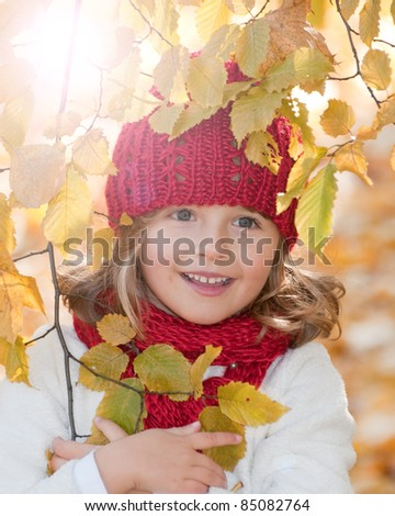 Autumn - Beautiful girl portrait in autumn park (space for text) - stock photo