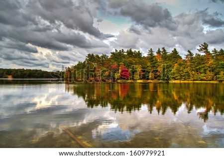 Autumn Beauty. View of Lost Lake in the autumn, with the sky reflected perfectly in the tranquil waters. Ludington State Park. Ludington, Michigan. - stock photo