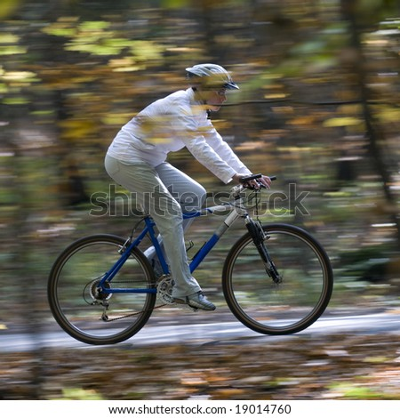 Autumn bike riding - stock photo