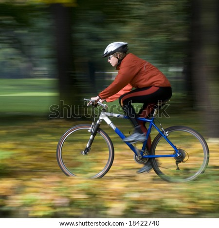 Autumn bike riding- intentional motion blur - stock photo