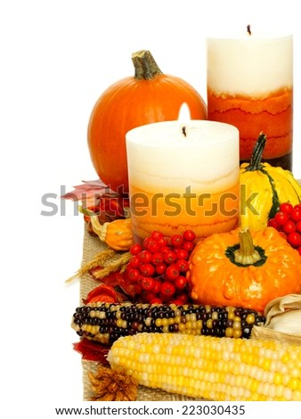Autumn border of pumpkins, vegetables and decor over white - stock photo