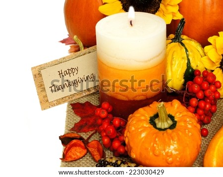 Autumn border with Happy Thanksgiving tag, decor and pumpkins  - stock photo