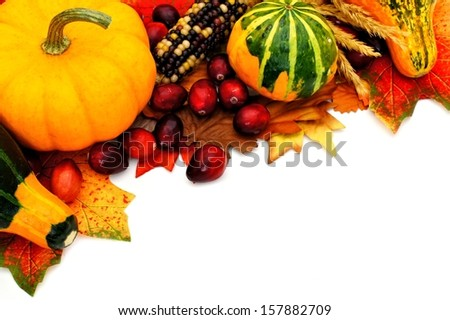 Autumn border with leaves, pumpkin, and gourds - stock photo