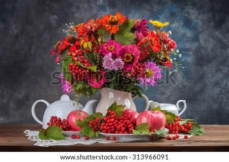 Autumn bouquet flower and tea. Food concept. - stock photo