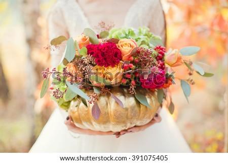 autumn bouquet in the golden pumpkin - stock photo
