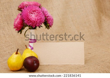 Autumn bouquet of chrysanthemum flowers in a white vase. Autumn colors maroon red. Flowers in a vase on the table - an autumn mood. Pink flower - Image for postcards. - stock photo