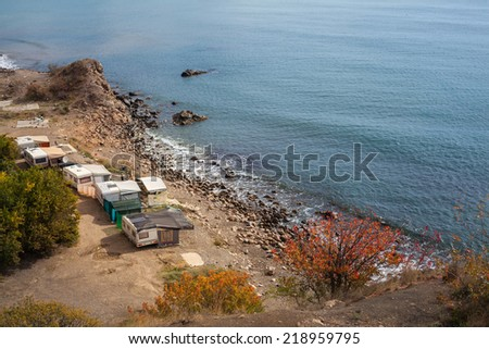 autumn camping on the beach near the mountains - stock photo