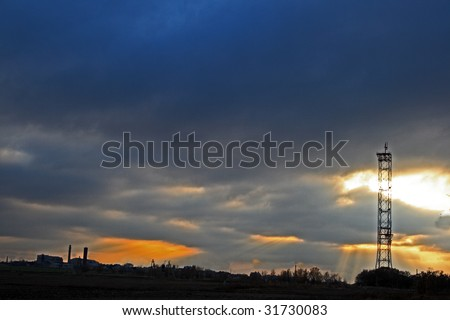 Autumn. Cell phone tower against night sky - stock photo