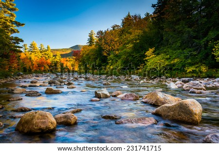 Autumn color along the Swift River, along the Kancamagus Highway in White Mountain National Forest, New Hampshire. - stock photo